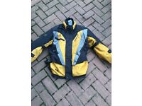 Motorbike jacket size large . REV IT with armour