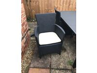 4 rattan garden chairs with cushions, perfect condition. Cost £150 brand new