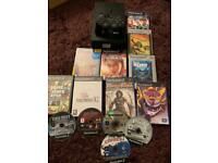 Black Sony ps2 console with games bundle