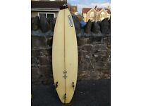 Custom tri-fin surfboard very good condition ready to use £250 ono 5ft 9 by 49cms