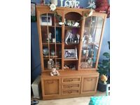 brown wall unit with brown frame and glass doors