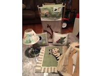 Jungle nursery accessory items - lamp, rug, laundry basket, nappy sack, pictures and cushions