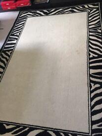 Cream rug with zebra striped edging