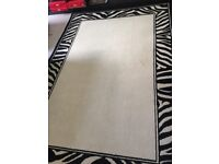Cream rug with zebra striped edging