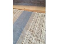 Large tan and blue accent rug in excellent shape
