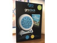 groclock with instructions, story and box.