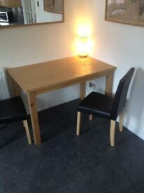 Oak style dining table and 4 chairs.
