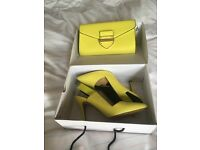 striking yellow size 6 Aldo heels and matching bag. Never worn.