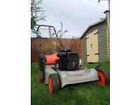 Lawnmower. Flymo Silver petrol lawn mower.
