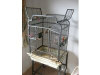 Large Bird cage. Opens top & front and shelf below for storage.