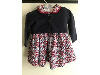 Baby girl dress with navy jacket.