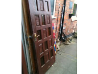 Exterior hardwood door with carved wood and yellow glass