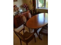 Oval Polished quality dining table and 6 chairs (2 carvers)