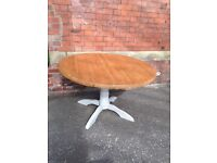 Round Pine dining table on painted pedestal leg