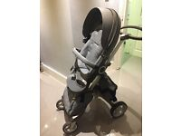 Gorgeous Stokke pushchair in black melange complete with car seat, ISO fix base and accessories