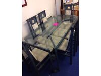 large glass dining table & 6 chairs **£125**