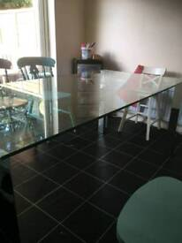 Toughened glass table