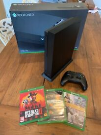Xbox One X plus Sea of Thieves controller + games + stand + box