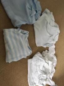 Bundle of tiny baby vests