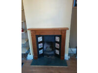 Tiled fireplace and wooden surround