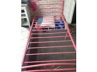 Pink Single Bed. Metal with 3 hearts at head and 1 at foot no mattress.