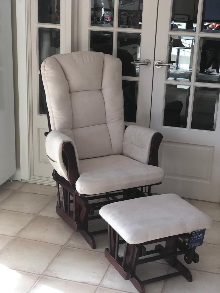 Brand new Hauck rocking glider nursing chair and foot stool antique pine beige fabric