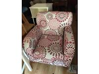 Lovely cream and red pattern arm chair with fire tag still attached