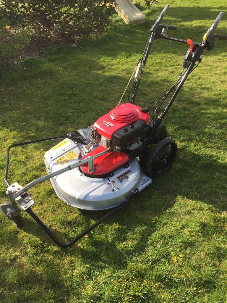 how to cut long grass with a push mower