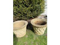 2 large decorative stone pots