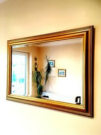 Gold Wall Mirror distinctive bevelled glass and a beautiful Gold frame. In Pristine condition. £37