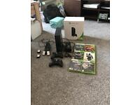 Xbox 360 E 250gb, charging kit, cables and games