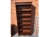 Wooden book case with adjustable shelves.