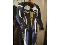 RST TRACTECH EVO ONE PIECE MOTORCYCLE RACE LEATHERS BLACK / WHITE / BLUE