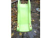 Green dinosaur slide