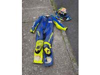 Dianese Rossi replica onre piece motorcycle suit , crash helmet