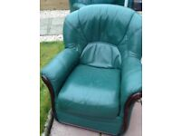Italian leather 3 piece deep green suite (one of the armchairs manual recliner)