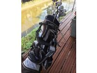 Set of golf clubs with carrying bag in good condition
