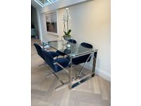 Modern glass and chrome 6 seater dining table