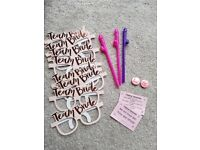 Selection of hen party items including 'team bride' glasses x 8, badges x 2, straws x 3 and cards