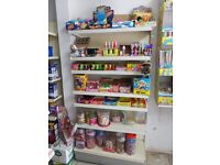 Full shop shelves including gondola