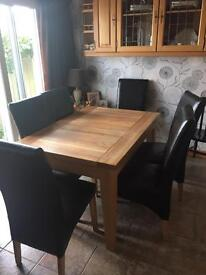 Solid Extending Oak Table and 6 Faux Leather Chairs