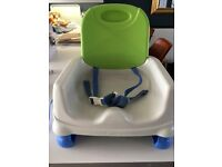 Fisher Price booster seat, portable with sections for food and cup. 3 point harness for safety