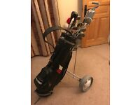 Set of 14 golf clubs in Sayers bag with golf trolley. Good condition.
