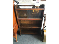 Appealing Small Dark Brown Wooden Bookcase with Sliding Glazed Doors