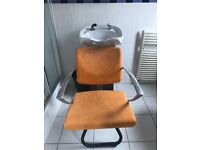 White ceramic back wash sink with hose & tap plus reclining chair