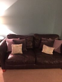 2 well used brown leather sofas- free