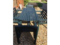 Garden table, 2 matching benches and 2 matching chairs