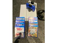 PS4 Glacier white limited edition for sale with 8 games and 2 original controllers