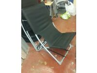 Two black deck chairs for sale