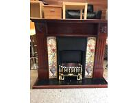 Solid mahogany wood fireplace with black inset & tiled surround £50